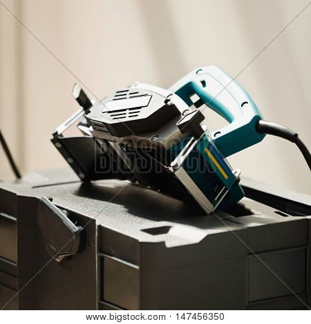 Modern hand planer power tool, color image, close up
