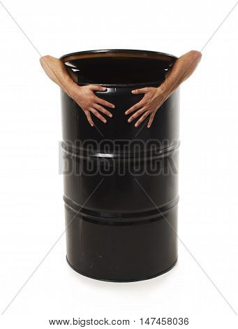 male hands of black barrel isolated on white background. man hiding in a barrel. the concept of avoiding problems.