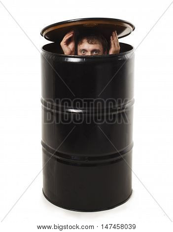 man hides in a barrel. businessman hiding in an empty barrel from the oil. the concept of avoiding problems. isolated on white background.