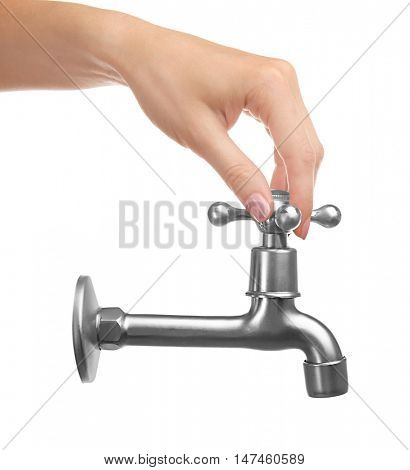 Female hand turning tap isolated on white. Water saving concept