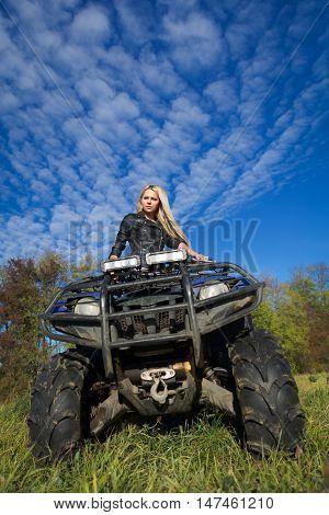 Elegant Blonde Woman Riding Extreme Quadrocycle Atv On Summer Field