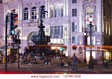 United Kingdom England London - 2016 June 17: Popular tourist Picadilly circus with flags union jack in night lights illumination