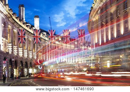 Popular Tourist Regent Street With Flags Union Jack At Night