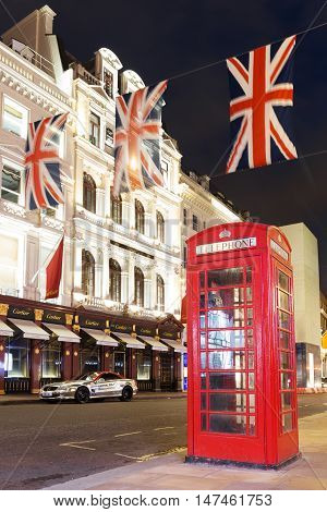 Popular Tourist Red Phone Booth With Flags Union Jack In Night L