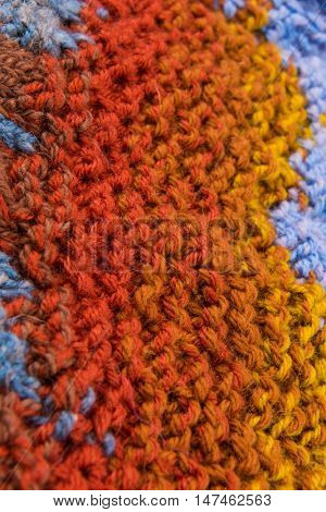 striped colorful wool texture handmade patten closeup macro blue red  yellow orange