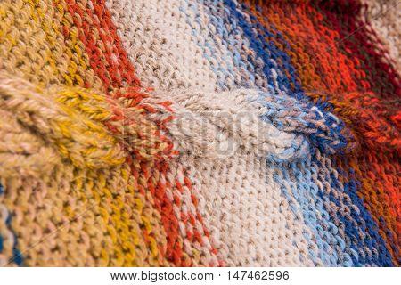 striped colorful wool texture handmade patten closeup macro blue red  yellow orange beige