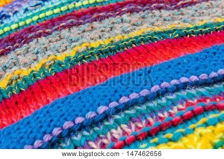 striped colorful wool texture handmade patten closeup macro blue red green yellow pink purple beige