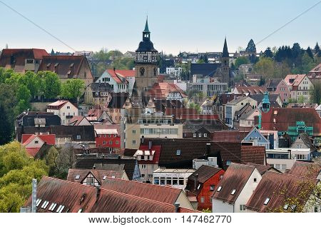 Landmarks of Backnang Baden-Wurttemberg Germany. Panoramic view of half-timbered houses with red tiled roofs and a church.