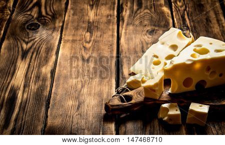 Pieces of fresh cheese on a cutting Board.