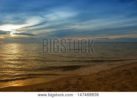 Sunrise Sea water beach and sky. motion of the sea in the morning. Cold Warm Filter look Colorful  with copy space.