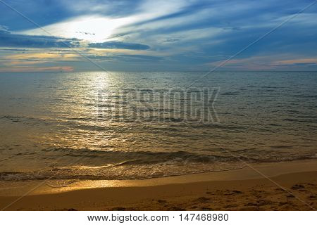 Sunrise reflective light background. Morning at sea beautiful colorful water sea at reflex. ( Cold Warm Filter) : copy space for add text above and may be used as background :