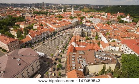 AERIAL. Sunny summer shot above Town Hall Square of Vilnius old town