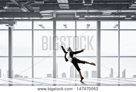 Dancing businesswoman in office . Mixed media