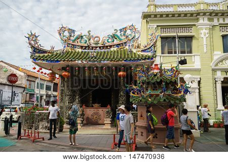 George Town, Malaysia - September 2016: Tourists in front of a Chinese temple, Choo Chay Keong temple, in George Town, Penang, Malaysia. George Town is a UNESCO world heritage site and a popular tourist destination.