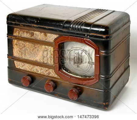 An old radio on a white background