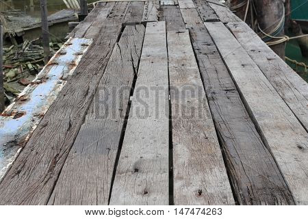 Old Wooden pier wooden bridge in evening. Select focus front  with shallow depth of field : space for add text above and may be used as background :