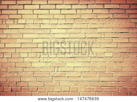 Abstract weathered texture of stained old dark stucco brown and painted red, yellow brick wall background in rural room. Grungy rusty square blocks of darken stonework retro color architect wallpaper