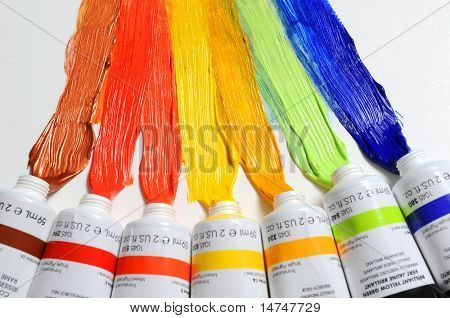 Paint of different colors spread over a white background