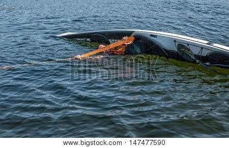 man rolling with a kayak on a lake - serial pictures 2 of 11