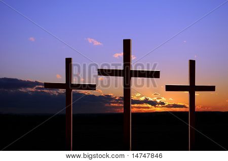 Colorful sunset with three crosses