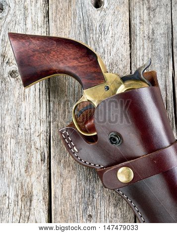 Old western six shooter  pistol in leather holster.