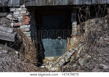 entrance to the rickety scary basement under the garage