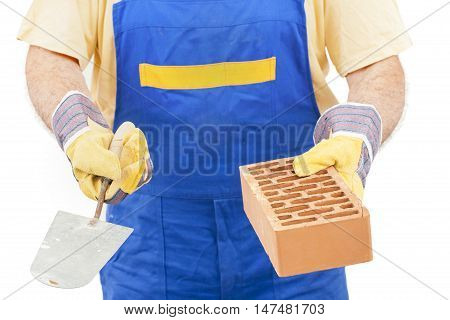 Construction worker with a brick and trowel in hands isolated on white background. Image with a clipping path.