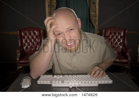 Worried Man At Computer