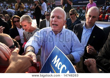 O'FALLON - AUGUST 31: Senator McCain and wife Cindy shake hands with the crowd at rally in O'Fallon near St. Louis, MO on August 31, 2008