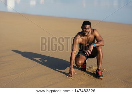 Athlete Taking A Running Workout Break At The Beach