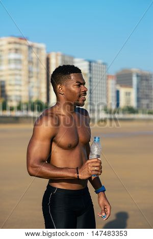 Athlete Taking A Running Workout Break For Drinking Water