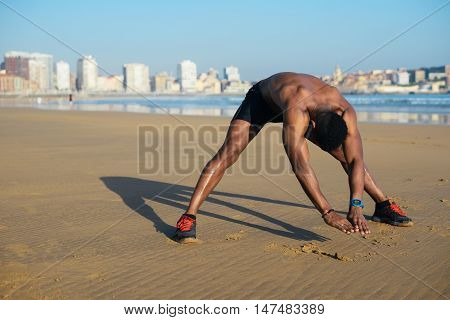 Runner Stretching Back And Hamstring Before Running