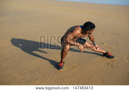 Runner Stretching Hamstring For Warming Up Before Running