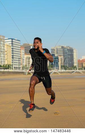 Runner Training At The Beach