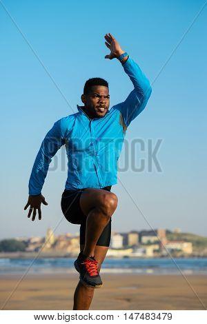Black Athlete Doing Power Skips Before Running