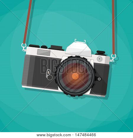 Old vintage photo camera with strap. Hanging retro camera. vector illustration in flat style on green background