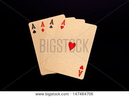 Golden playing cards four aces on black background. For luxury game