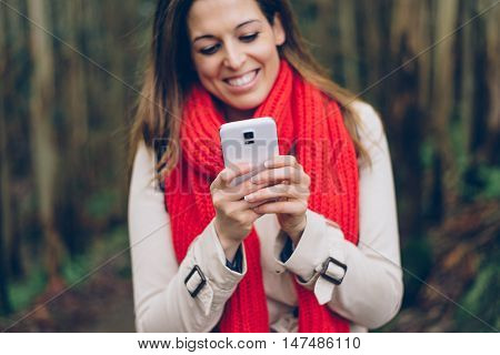 Detail Of Woman Texting On Smartphone
