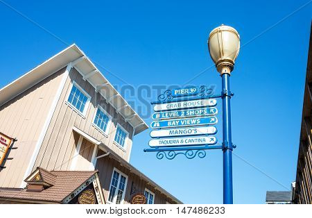 San Francisco USA - September 21 2015: A sign of the attractions shops and restaurants in the Pier 39.