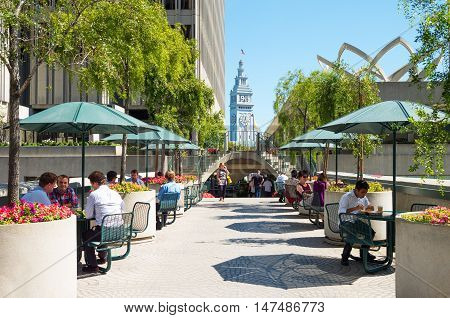 San Francisco USA - September 21 2015: People in an open air bar between the skyscrapers of the Embarcadero Center