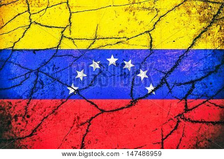 Vintage flag of Venezuela with cracks - Political/Economic concept