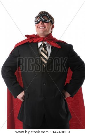 Businessman with red cape and goggles smiling confidently