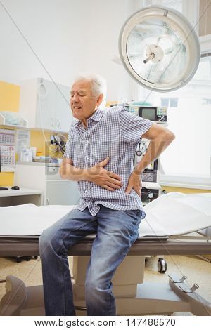 Mature man with lower back pain at the hospital