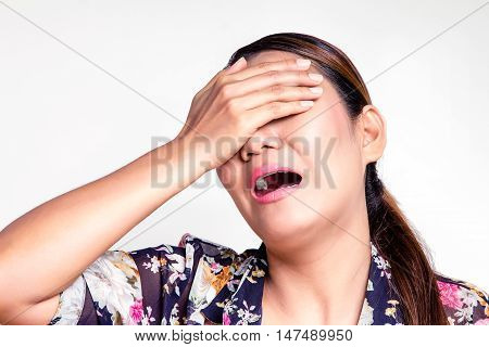Asian woman covering her eyes and yell