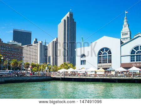 San Francisco USA - September 26 2015: View of the Ferry Buildinbg with the skyscrapers of the Embarcadero Center