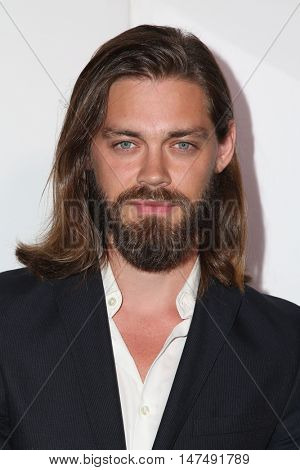 LOS ANGELES - SEP 15:  Tom Payne at the Audi Celebrates The 68th Emmys at the Catch on September 15, 2016 in West Hollywood, CA