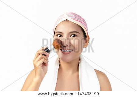 Asian Woman Applying Makeup On Face By Brush