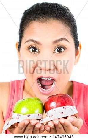 asian woman with apple and tape measure
