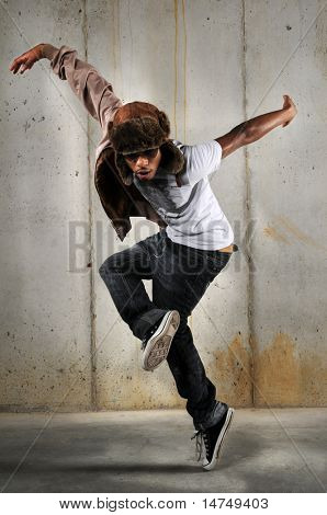 African American hip hop man dancing over a grungy background