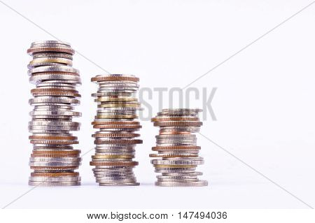 growing money graph on a row of coin and pile of bath coins stack  on white background finance business isolated